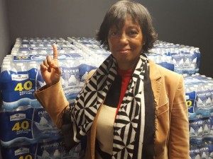 Pharrell Williams' mother, Dr. Carolyn Williams, donating to Shaggy's water drive at Z104. (Photo: 13News Now)